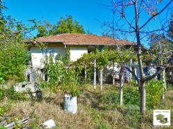 Two-storey house with big yard, accessible from three roads, set in the center of the village Balvan, only 15 km away from Veliko Tarnovo