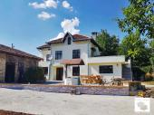 Renovated, partly furnished two-storey house with flat garden in the village of Gorna Lipnica.